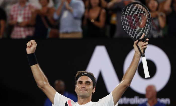 Switzerland's Roger Federer celebrates winning the final against Croatia's Marin Cilic at the Australian Open Men's singles final, Melbourne, Australia, on January 28, 2018. (Reuters/Issei Kato)
