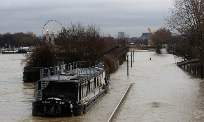 A view shows a peniche boat moored along the flooded banks of the River Seine after days of almost non-stop rain caused flooding in the country in Paris, France Jan. 28, 2018. (Reuters/Gonzalo Fuentes)
