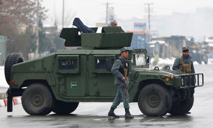 Afghan policemen keep watch near the site of an attack at the Marshal Fahim military academy in Kabul, Afghanistan Jan. 29, 2018. (Reuters/Mohammad Ismail)