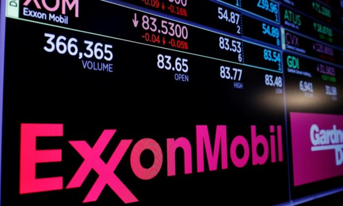 A logo of Exxon Mobil is displayed on a monitor above the floor of the New York Stock Exchange shortly after the opening bell in New York, U.S., December 5, 2017.  REUTERS/Lucas Jackson - RC17B6EE3C30