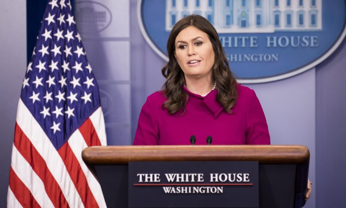 White House Press Secretary Sarah Sanders talks about the 15 guests invited to sit with the First Lady during the president's State of the Union address on Tuesday, at the White House in Washington on Jan. 29, 2018. (Samira Bouaou/The Epoch Times)