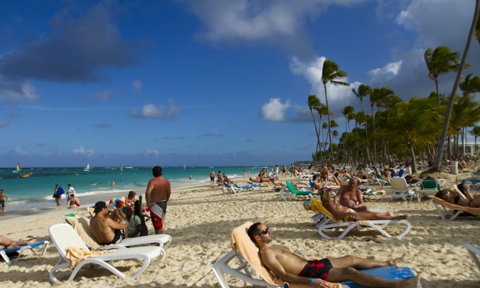 Tourists rest at Bavaro beach in Punta Cana, Dominican Republic, on Jan. 16, 2012. (Erika Santelices/AFP/Getty Images)
