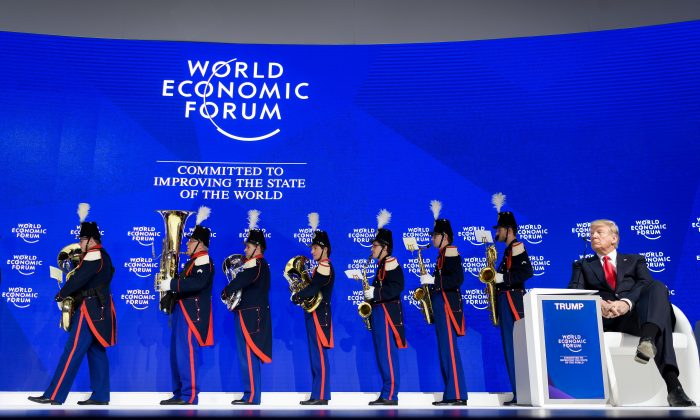 President Trump watches as the Landwehr Fribourg band leaves the stage during the WEF annual meeting in Davos, on Jan. 26, 2018. (FABRICE COFFRINI/AFP/Getty Images)