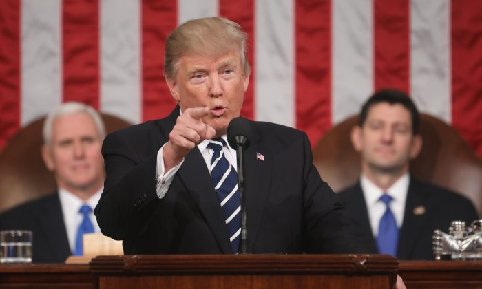 U.S. President Donald J. Trump delivers his first address to a joint session of Congress from the floor of the House of Representatives in Washington, DC, on Feb. 28, 2017. On Jan. 30, 2018, Trump will deliver his first State of the Union address. (JIM LO SCALZO/AFP/Getty Images)