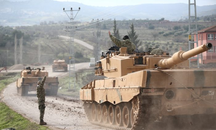 A Turkish military convoy arrives at a village on the Turkish-Syrian border in Kilis province, Turkey. (Reuters/Stringer)