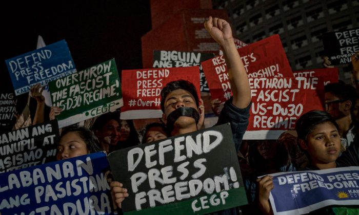 Journalists and activists stage a protest calling to defend press freedom on January 19, 2018, in suburban Quezon City in Metro Manila, Philippines. (Jes Aznar/Getty Images)
