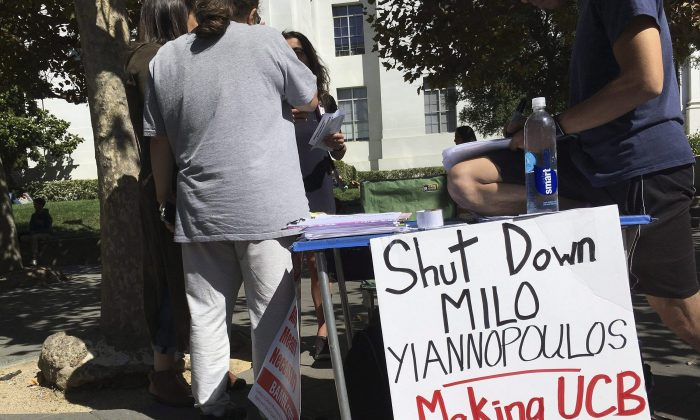 """A booth calls for protesters to """"shut down"""" controversial right-wing commentator Milo Yiannopoulos, on Sproul Plaza at the University of California, Berkeley on Sept. 21, 2017. (Jocelyn Gecker/AP Photo)"""