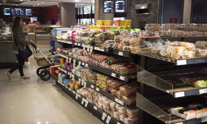 Various brands of bread sit on shelves in a grocery store in Toronto. (The Canadian Press/Doug Ives)