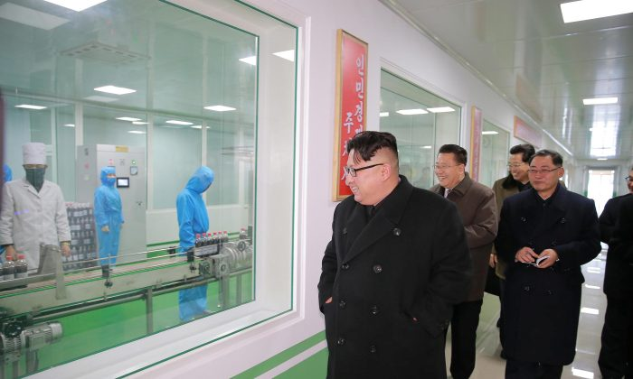 North Korean leader Kim Jong Un gives field guidance at the Pyongyang Pharmaceutical Factory, in this undated photo released by North Korea's Korean Central News Agency (KCNA) in Pyongyang January 25, 2018. (KCNA / via REUTERS)