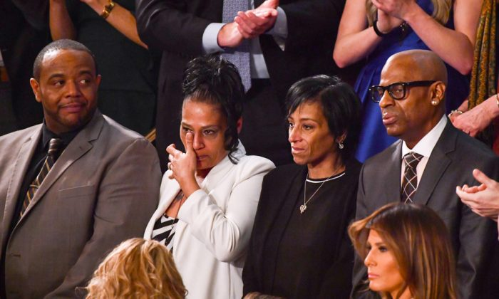 (L–R) Robert Mickens, Elizabeth Alvarado, Evelyn Rodriguez, and Freddy Cuevas—parents of slain teenage girls—are recognized during the State of the Union address at the U.S. Capitol on Jan. 30, 2018. (NICHOLAS KAMM/AFP/Getty Images)