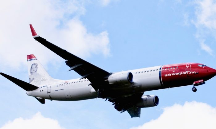 A Boeing 737-800 of Low-cost airline Norwegian flying near Oslo airport in Gardermoen. (Kyrre Lien/AFP/Getty Images)