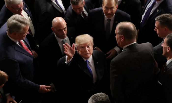 President Donald J. Trump waves to guests calling his name from the galleries following the State of the Union address in the chamber of the U.S. House of Representatives in Washington, DC, Jan. 30, 2018. This is the first State of the Union address given by President Trump and his second address to a joint meeting of Congress. (Chip Somodevilla/Getty Images)