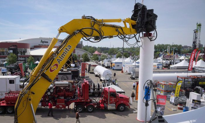 Heavy machinery on display at the Global Petroleum Show in Calgary in a 2016 file photo. Five years after Alberta raised a record-setting $3.5 billion at auctions of provincially owned oil and gas drilling rights, sales are on pace this year to set a historic low, part of a downward trend seen across Western Canada. (The Canadian Press/Jeff McIntosh, File)