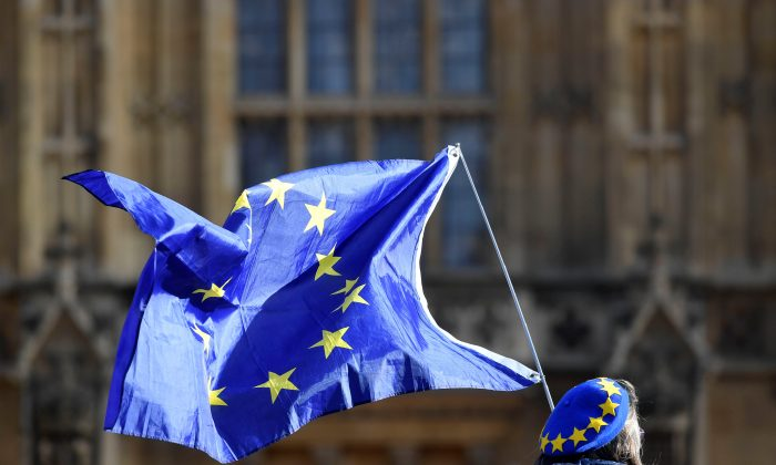 An anti-Brexit demonstrator waves a EU flag outside the Houses of Parliament in London, Britain, January 30, 2018. (Reuters/Toby Melville)