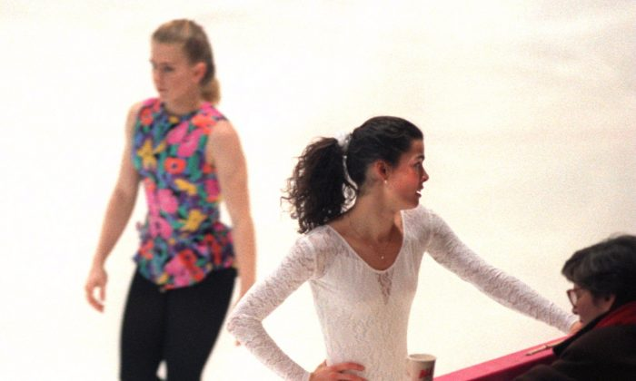 Tonya Harding walks by as Nancy Kerrigan of the USA takes a break during practice in Lillehammer, Norway. (Pascal rondeau/Allsport)