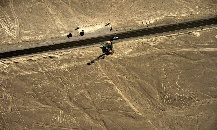 Aerial view of geoglyphs representating a guarango tree (L) and hands, at Nazca Lines, some 435 km south of Lima, Peru on Dec. 11, 2014. (Martin Bernetti/AFP/Getty Images)