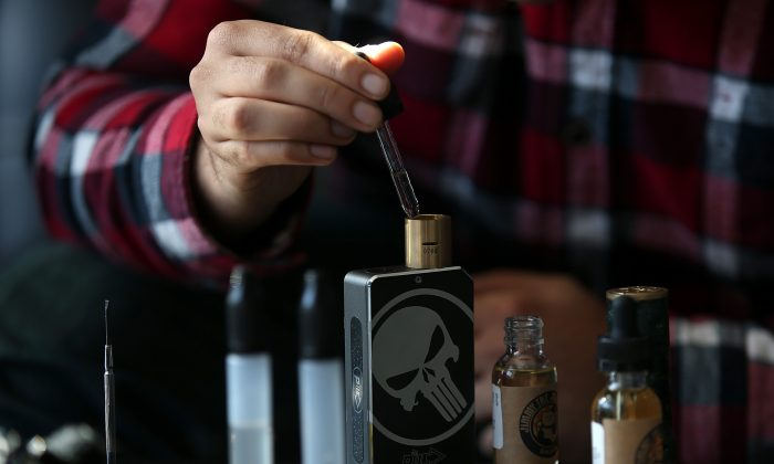 A customer fills a vaporizer, or E-Cigarette, with oil in San Rafael, Calif., on Jan. 28, 2015. (Justin Sullivan/Getty Images)