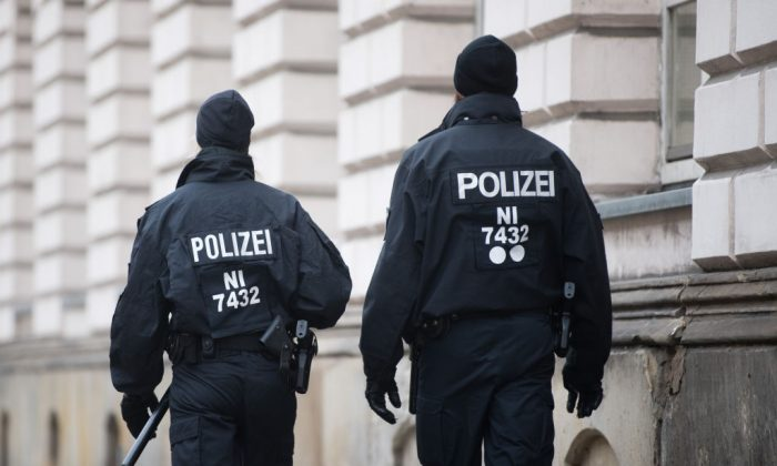 Policemen patrol in front of the court in Celle near Hanover, central Germany, prior to the continuation of the trial against notorious Iraqi hate preacher Abu Walaa (unseen), described as the ISIS group's de facto leader in Germany, on November 7, 2017.