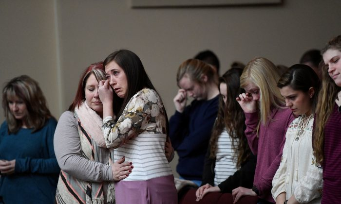 Students attend a prayer vigil for students killed and injured after a 15-year-old boy opened fire with a handgun at Marshall County High School, at Life in Christ Church in Marion, Kentucky on Jan. 23, 2018. (REUTERS/Harrison McClary)