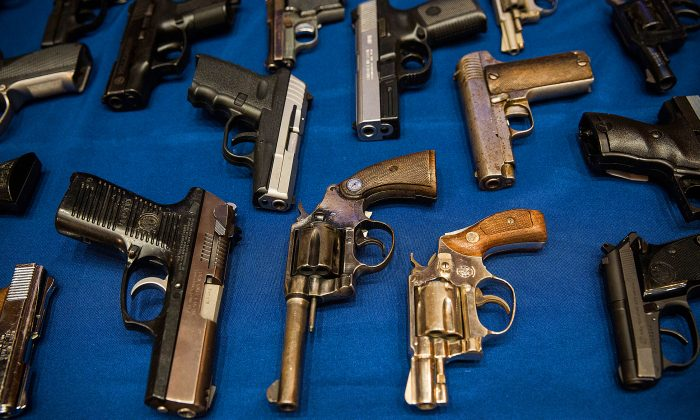 Guns seized by the New York Police Department in the largest seizure of illegal guns in the city's history, are displayed during a press conference, Aug. 19, 2013 in New York City. (Andrew Burton/Getty Images)