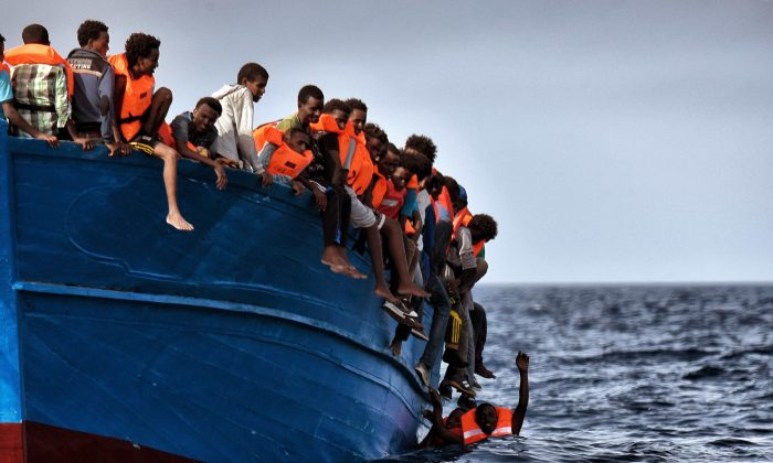 Migrants wait to be rescued as they drift in the Mediterranean Sea in a file photo. (Aris Messinis/AFP/Getty Images)