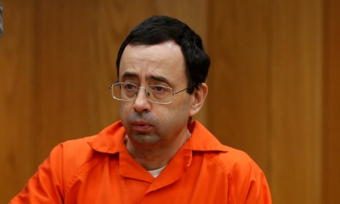 Larry Nassar, a former team USA Gymnastics doctor who pleaded guilty in November 2017 to sexual assault charges, sits in the courtroom during his sentencing hearing in the Eaton County Court in Charlotte, Michigan, U.S., February 2, 2018.  (Reuters/Rebecca Cook)