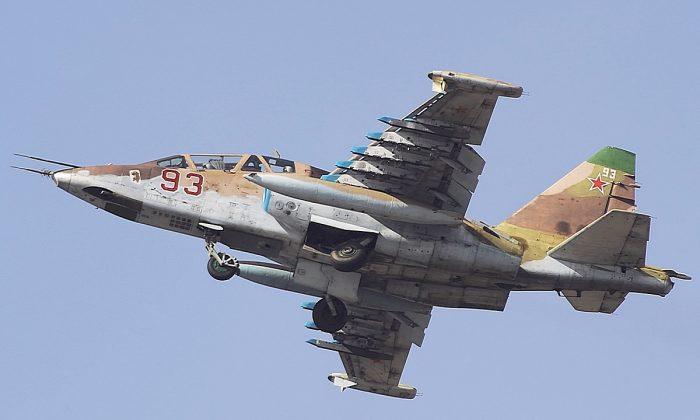 """(""""Su-25 93 red"""" by Aleksander Markin [CC BY-SA-2.0 (ept.ms/2utDIe9)])"""