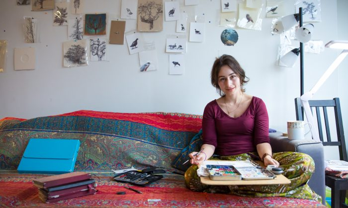 Artist Dina Brodsky with her painting materials at her home in Long Island City in Queens, New York, on Jan. 22, 2018. (Benjamin Chasteen/The Epoch Times)