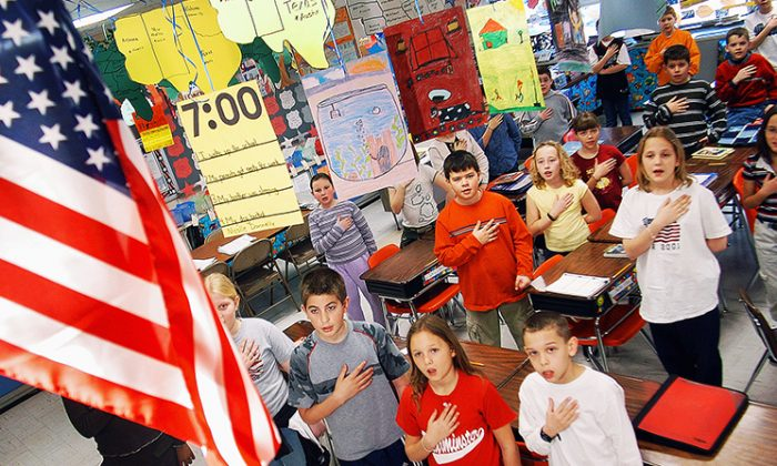 Fourth-graders at Longstreth Elementary School pledge allegiance to the flag March 24, 2004, in Warminster, Pa. (William Thomas Cain/Getty Images)