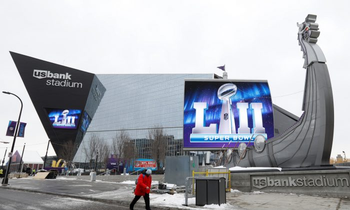 A man walks by US Bank Stadium, home to this weekend's Super Bowl, in downtown Minneapolis, Minnesota, U.S. January 30, 2018. (Reuters/Kevin Lamarque)