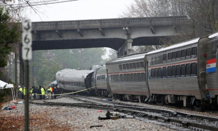 Emergency responders are at the scene after an Amtrak passenger train collided with a freight train and derailed in Cayce, South Carolina, on Feb. 4, 2018. (Reuters/Randall Hill)