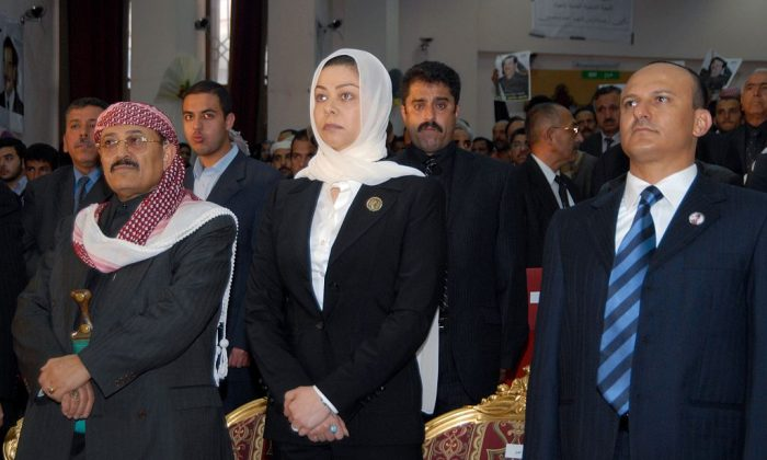 Raghad Saddam Hussein (C), the daughter of the late former Iraqi dictator Saddam Hussein, attends a memorial service held in Yemen on the 40th day after his execution on Feb. 7, 2007. (Khaled Fazaa/AFP/Getty Images)