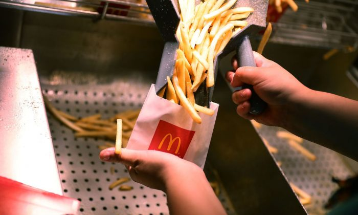 McDonald's employee Samantha Medina prepares french fries on April 25, 2017, in Miami. (Joe Raedle/Getty Images)