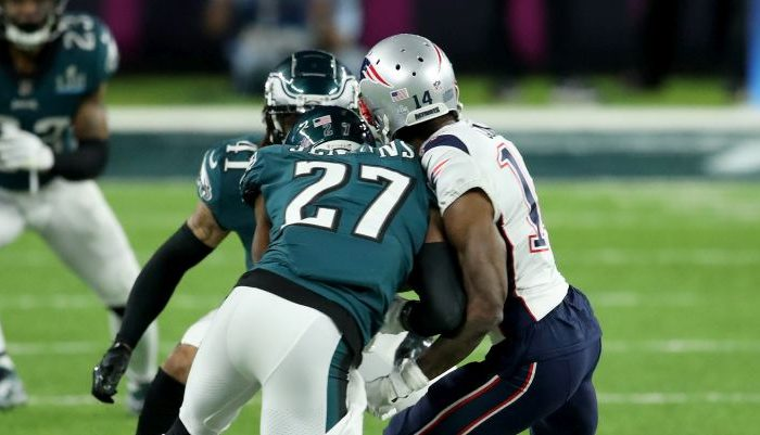 Malcolm Jenkins #27 of the Philadelphia Eagles tackles Brandin Cooks #14 of the New England Patriots during the second quarter in Super Bowl LII at U.S. Bank Stadium on Feb. 4, 2018 in Minneapolis, Minnesota. (Andy Lyons/Getty Images)