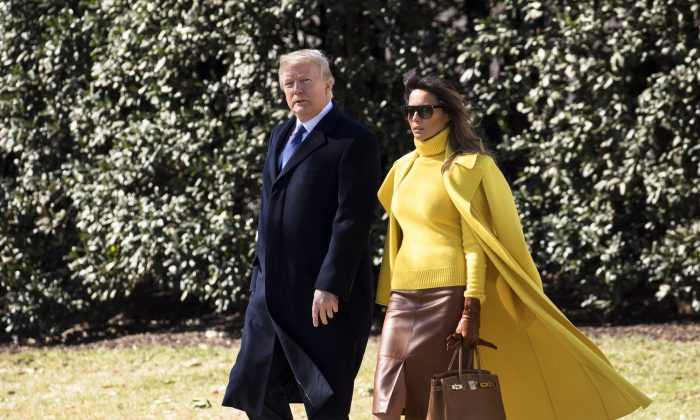 President Donald Trump and First Lady Melania Trump about to board Marine One on the South Lawn of the White House in Washington en route to Joint Base Andrews to depart to Cincinnati, Ohio, on Jan. 1, 2018. (Samira Bouaou/The Epoch Times)