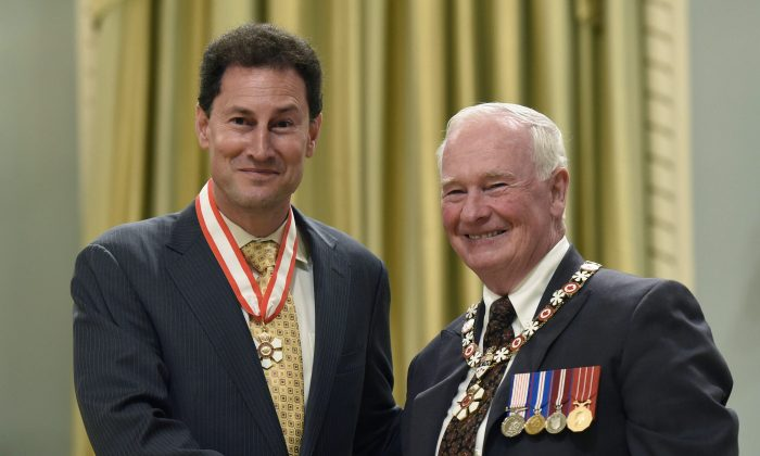 Former governor general David Johnston invests Steve Paikin as an Officer of the Order of Canada during a ceremony at Rideau Hall on May 8, 2015, in Ottawa. (The Canadian Press/Justin Tang)