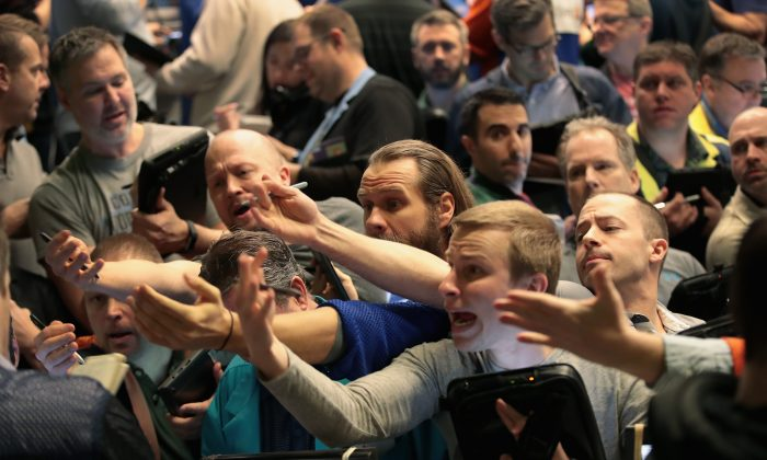 Traders signal offers in the S&P options pit at the Cboe Global Markets Inc. exchange in Chicago on Feb. 6.  (Scott Olson/Getty Images)