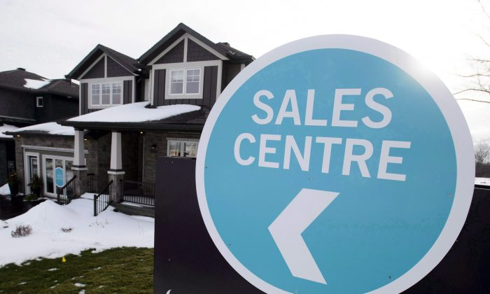 A sales center sign is shown outside a house under construction in Beckwith, Ont., on Jan. 11, 2018. The mortgage business faces challenges from rising rates and the newly implemented stress test from the federal regulator. (The Canadian Press/Sean Kilpatrick)