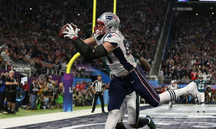 New England Patriots tight end Rob Gronkowski (87) catches a touchdown defended by Philadelphia Eagles cornerback Ronald Darby (41) during the fourth quarter in Super Bowl LII at U.S. Bank Stadium on Sunday. Matthew Emmons-USA TODAY Sports (file photo)