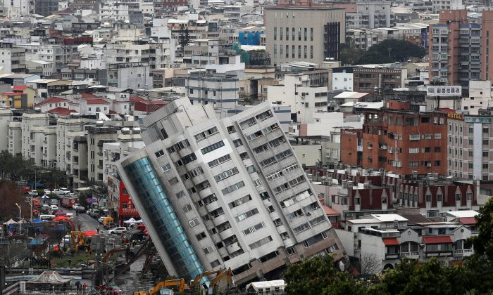 A damaged damaged building is seen after an earthquake hit Hualien, Taiwan on Feb. 8, 2018. (Reuters/Tyrone Siu)
