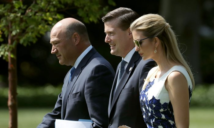 "WASHINGTON, DC - AUGUST 30:  (L-R) National Economic Council Director Gary Cohn, White House Staff Secretary Rob Porter and Ivanka Trump walk across the South Lawn before departing the White House with U.S. President Donald Trump August 30, 2017 in Washington, DC. Trump is taking a day trip to Springfield, Missouri, to participate in a ""tax reform kickoff event,"" according to the White House.  (Photo by Chip Somodevilla/Getty Images)"