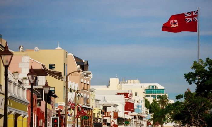 The flag of Bermuda flies along the commercial and retail district on Front Street, November 8, 2017 in Hamilton, Bermuda. (Drew Angerer/Getty Images)