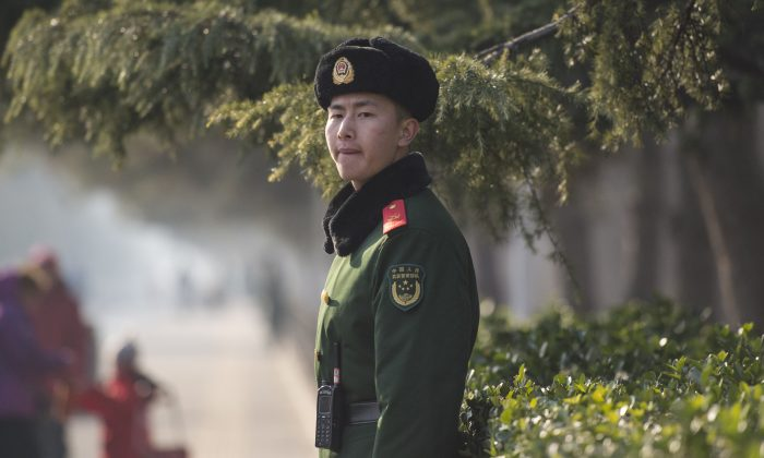A Chinese paramilitary officer guards over the Diaoyutai State Guesthouse in Beijing, China on Dec. 2, 2017. (Fred Dufour/AFP/Getty Images)