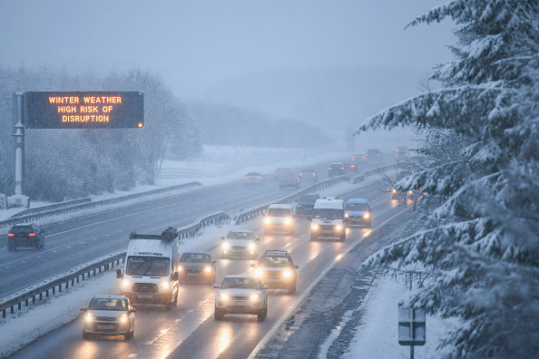 Motorists travel through a heavy snow shower on the M8 on Jan. 16, 2018, in Harthill, Scotland. (Jeff J Mitchell/Getty Images)