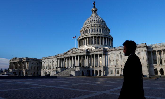 People walk by the U.S. Capitol building in Washington, U.S., Feb. 8, 2018. (Reuters/Leah Millis)