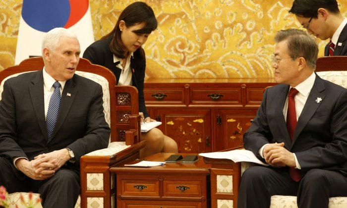 U.S. Vice President Mike Pence and South Korean President Moon Jae-in talk during their meeting at the presidential office Cheong Wa Dae, Blue House in Seoul, South Korea Feb. 8, 2018. (Reuters/Kim Hee-chul/Pool)