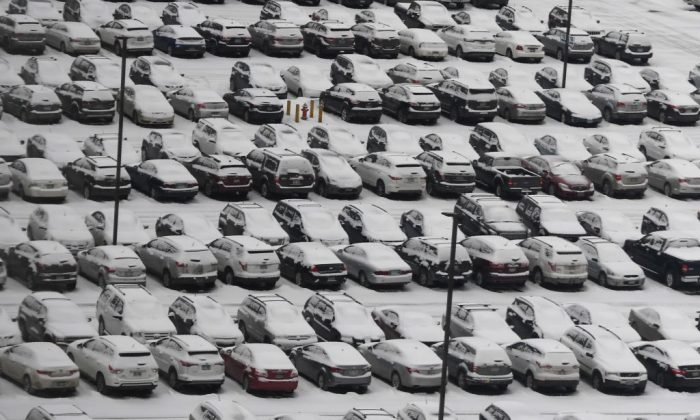 Cars park at an airport Park N' Fly, are covered in snow in the area around the airport in  Bloomington, Minnesota Feb. 3, 2018 leading up to Super Bowl LII. (Timothy A. Clary/AFP/Getty Images)