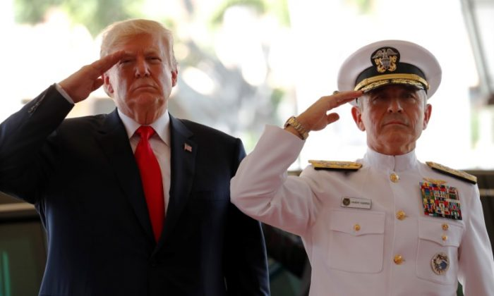 U.S. President Donald Trump is welcomed by U.S. Navy Admiral Harry Harris, commander of United States Pacific Command, at its headquarters in Aiea, Hawaii, U.S. Nov. 3, 2017. (Reuters/Jonathan Ernst)