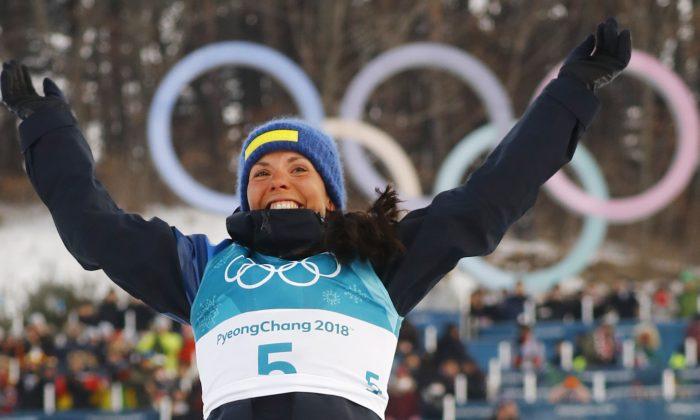 Winner Charlotte Kalla of Sweden won the first gold medal. (Reuters/Kai Pfaffenbach)