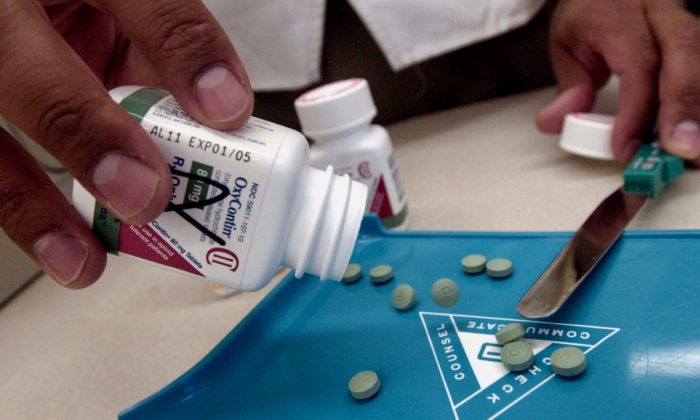 The prescription medicine OxyContin is displayed at a Walgreens drugstore in Brookline, MA on August 21, 2001. (Photo by Darren McCollester/Getty Images)